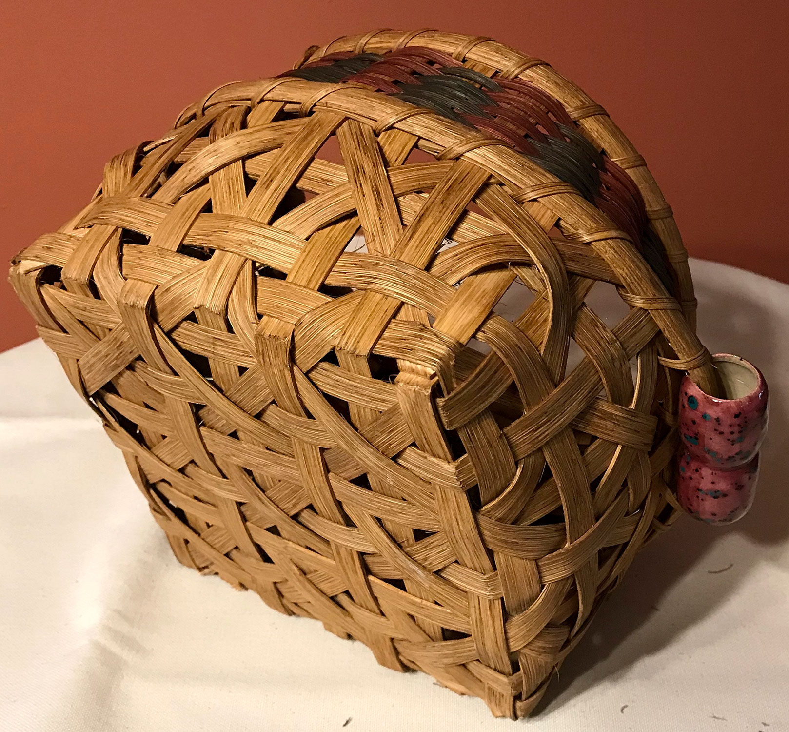 Bottom of an Intricate Basket with Ceramic Handles